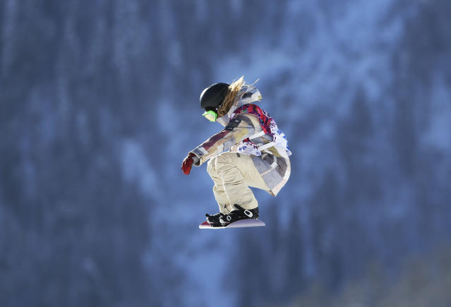 Jamie Anderson of the United States takes a jump during a Snowboard Slopestyle training session at the Rosa Khutor Extreme Park, prior to the 2014 Winter Olympics, Tuesday, Feb. 4, 2014, in Krasnaya Polyana, Russia. (AP Photo/Sergei Grits)