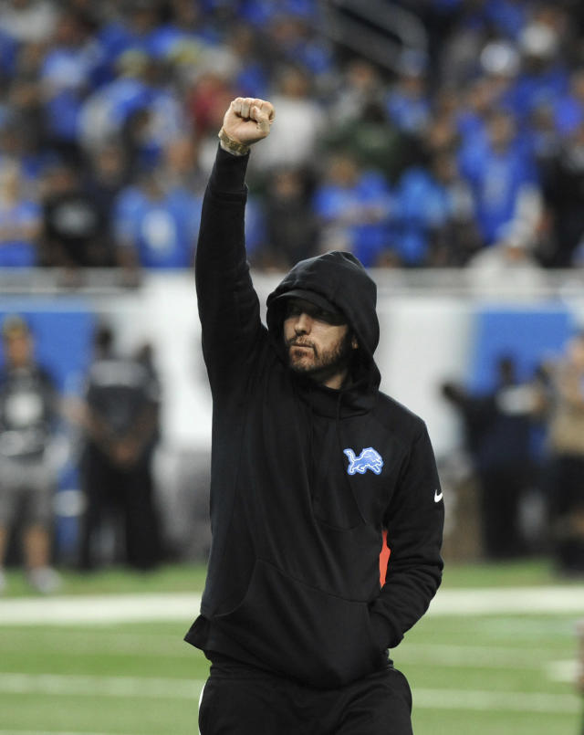 Eminem acknowledges the crowd at an NFL football game between the Detroit Lions and New York Jets in Detroit, Monday, Sept. 10, 2018. (AP Photo/Jose Juarez)