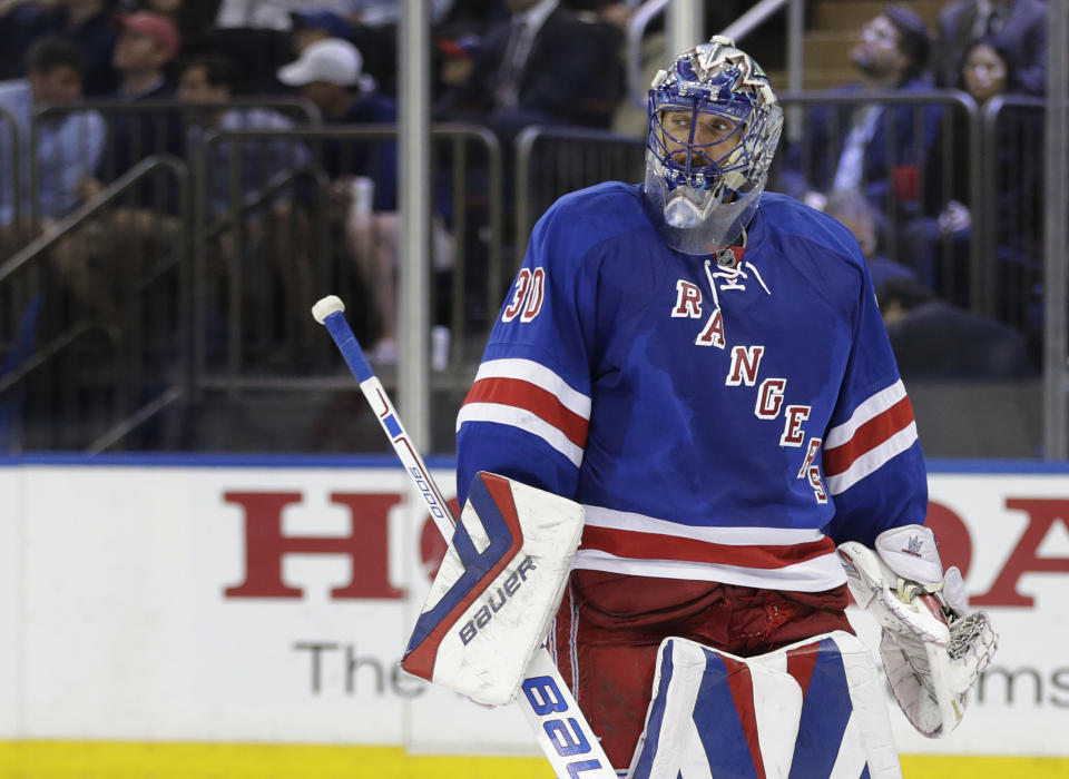 New York Rangers goalie Henrik Lundqvist (30) skates back to the crease during a break in play against the Tampa Bay Lightning during the third period of Game 5 of the Eastern Conference final during the NHL hockey Stanley Cup playoffs, Sunday, May 24, 2015, in New York. The Lightning won 2-0. (AP Photo/Frank Franklin)