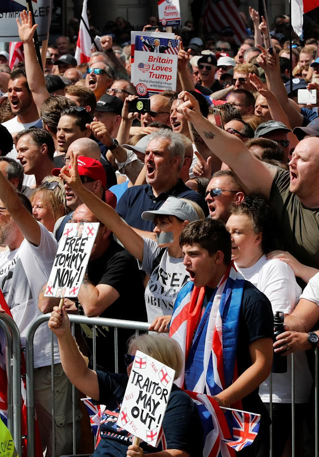 <p>Demonstrators hold placards supporting English Defense League founder Tommy Robinson and President Trump in London, July 14, 2018. (Photo: Yves Herman/Reuters) </p>