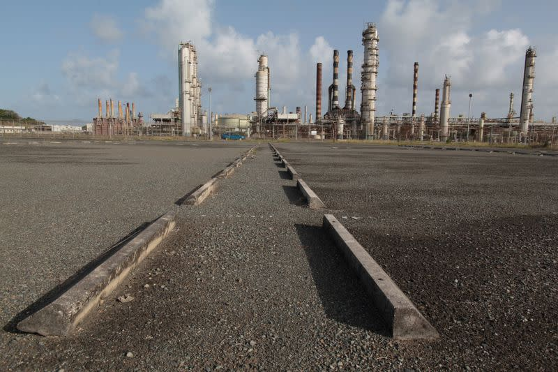 FILE PHOTO: An abandoned parking lot is seen outside the installations of the Hovensa petroleum refinery in St Croix