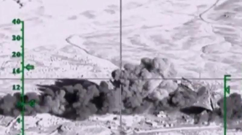 Image taken from footage on the Russian Defence Ministry website purporting to show airstrikes by the Russian air force on an Islamic State facility in the Syrian province of Deir Ezzor