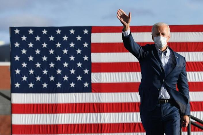 Democratic presidential nominee Joe Biden waves to supporters before speaking at a drive-in rally in Pennsylvania