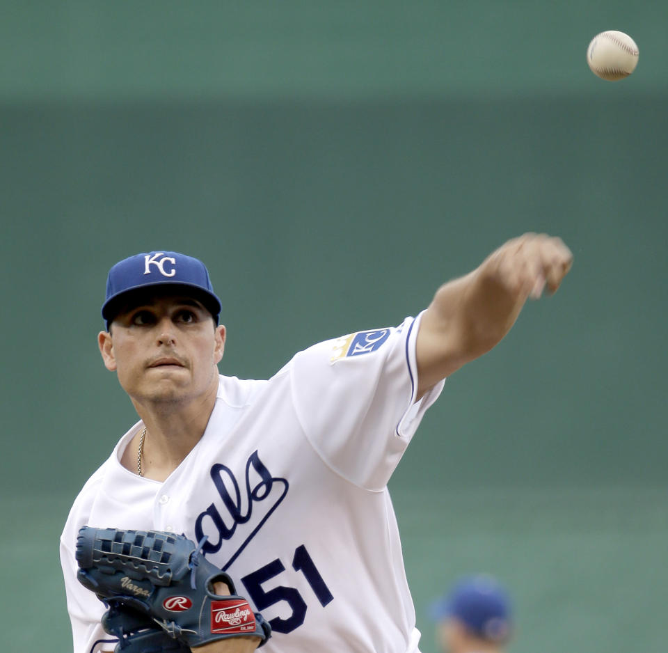 Kansas City Royals starting pitcher Jason Vargas throws during the first inning of a baseball game against the Pittsburgh Pirates Tuesday, July 21, 2015, in Kansas City, Mo. (AP Photo/Charlie Riedel)