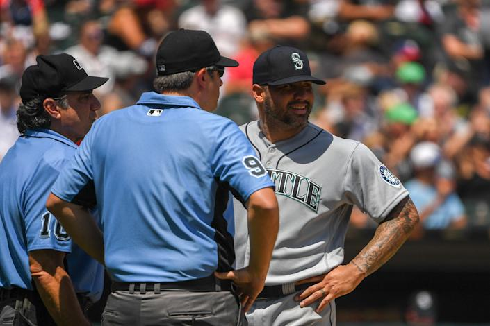 Mariners pitcher Hector Santiago was ejected from the game after umpires inspected his glove. (Photo by Quinn Harris/Getty Images)