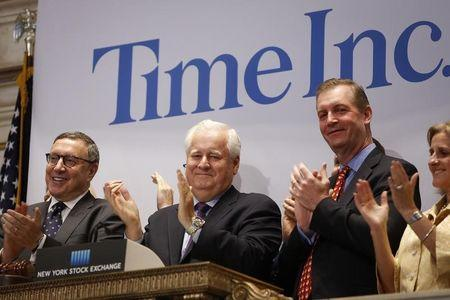 FILE PHOTO: Time Inc. CEO Joe Ripp claps after ringing the bell to open trading at the New York Stock Exchange
