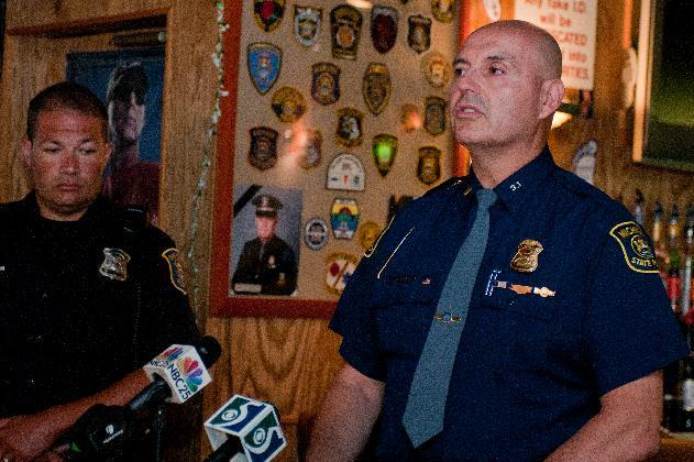 Michigan State Police Lt. Amado Arceo talks about stepped up drunken driving enforcement efforts during a news conference at Green Hut, 1301 Columbus Ave. in Bay City, Mich., July 2, 2012. Michigan hopes to keep drunks off the road with the help from a special message in men's bathrooms featuring an attention-getting woman's voice. (AP Photo/The Bay City Times, Yfat Yossifor)