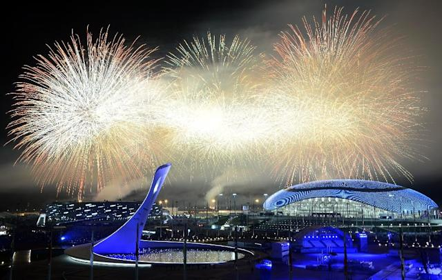 Fireworks explode around the Fisht Olympic Stadium at the end of the Closing Ceremony of the Sochi Winter Olympics, on February 23, 2014 (AFP Photo/Alexander Nemenov)