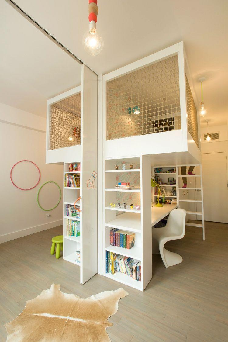 <p>Just because you don't have a giant space doesn't mean there isn't room for play—it's all about using space strategically. In this manhattan apartment, Studio DB went vertical to create a play pen above a desk, which the child can use as a hang out spot or reading nook when they're older. The pocket door also makes the tiny room feel like double the size. </p>
