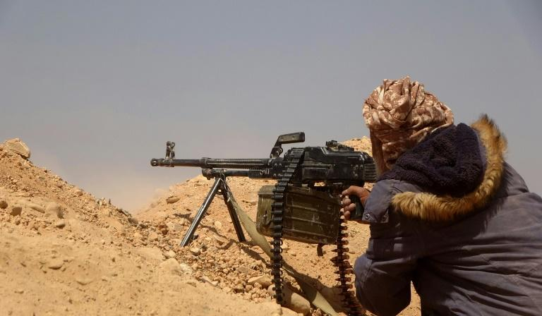 A fighter loyal to Yemen's Saudi-backed government gets into position during clashes with advancing Huthi rebels in Marib province earlier this month