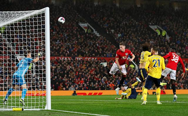 "Soccer Football - Premier League - Manchester United v Arsenal - Old Trafford, Manchester, Britain - September 30, 2019 Manchester United's Scott McTominay heads the ball at goal REUTERS/Andrew Yates EDITORIAL USE ONLY. No use with unauthorized audio, video, data, fixture lists, club/league logos or ""live"" services. Online in-match use limited to 75 images, no video emulation. No use in betting, games or single club/league/player publications. Please contact your account representative for further details."