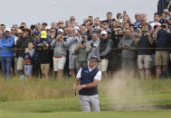 United States' Phil Mickelson plays out of a bunker on the 1st hole during the second round of the British Open Golf Championship at Royal St George's golf course Sandwich, England, Friday, July 16, 2021. (AP Photo/Ian Walton)