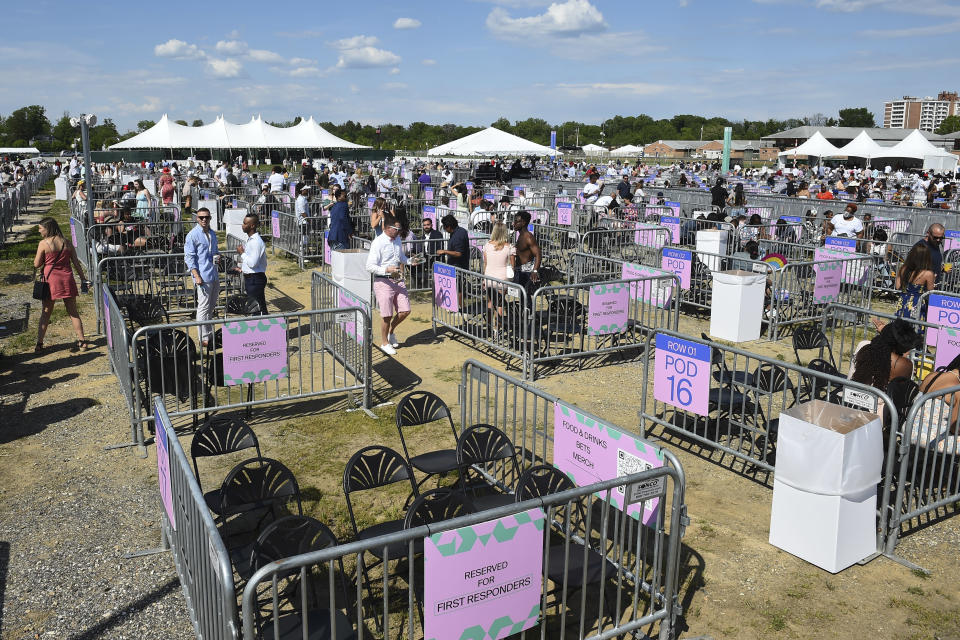 Socially distanced areas are seen near a stage during a concert in the infield during the 146th Preakness Stakes horse race at Pimlico Race Course, Saturday, May 15, 2021, in Baltimore. (AP Photo/Will Newton)