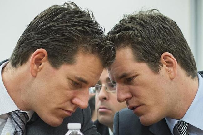 Brothers Cameron (L) and Tyler Winklevoss talk to each other as they attend a New York State Department of Financial Services (DFS) virtual currency hearing in the Manhattan borough of New York January 28, 2014. REUTERS/Lucas Jackson