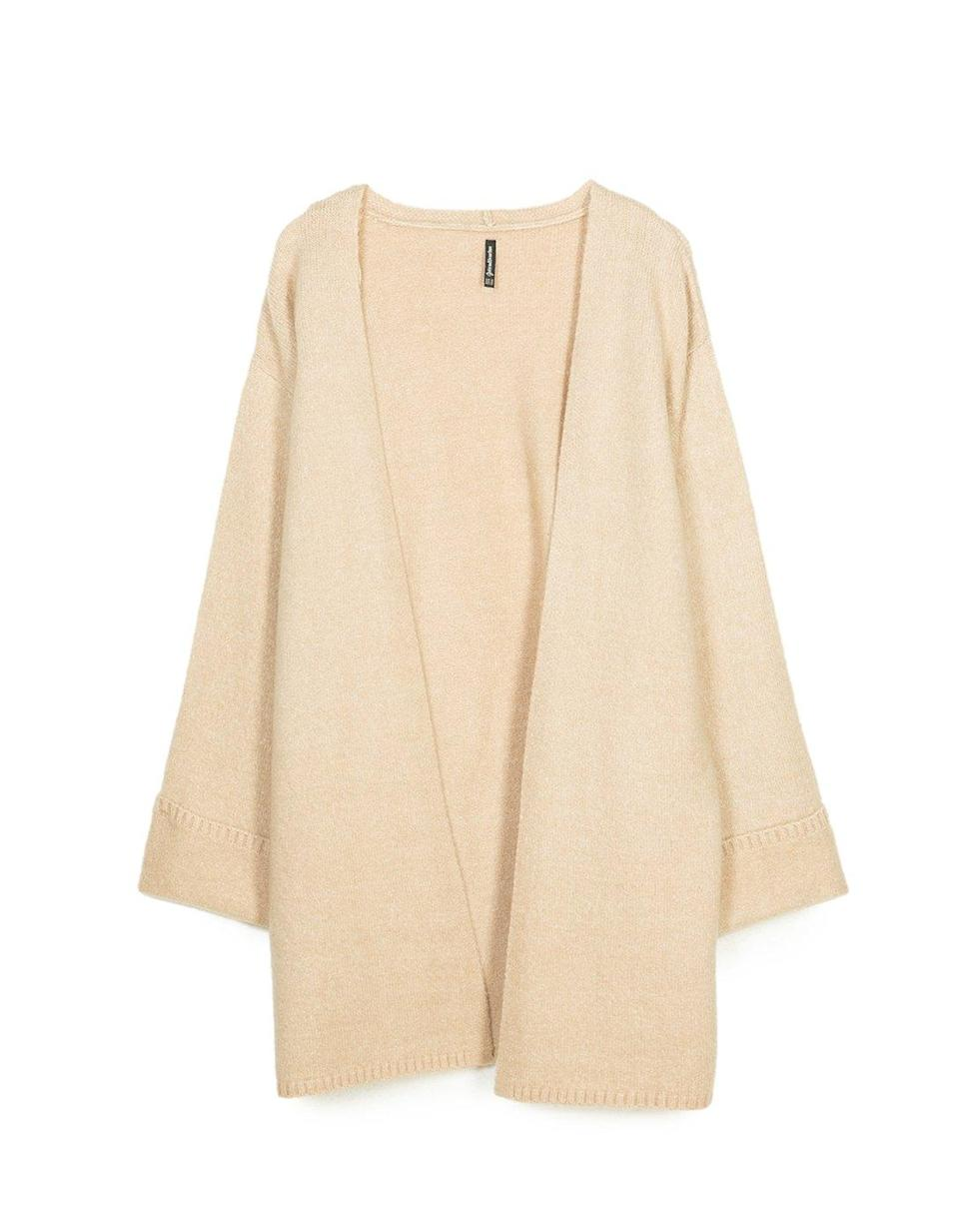 """<p>Why not tackle two trends in one and opt for a kimono-inspired knit this season? <em><a rel=""""nofollow noopener"""" href=""""https://www.stradivarius.com/gb/woman/clothing/knitwear/view-all/cardigan-with-kimono-sleeves-c1718564p300398009.html?colorId=210&style=05"""" target=""""_blank"""" data-ylk=""""slk:Stradivarius"""" class=""""link rapid-noclick-resp"""">Stradivarius</a>, £29.99</em> </p>"""
