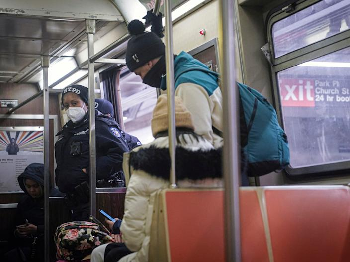 <p>Police patrol the A line subway train bound to Inwood, after NYPD deployed an additional 500 officers into the subway system following deadly attacks, Saturday 13 February 2021</p> ((Associated Press))