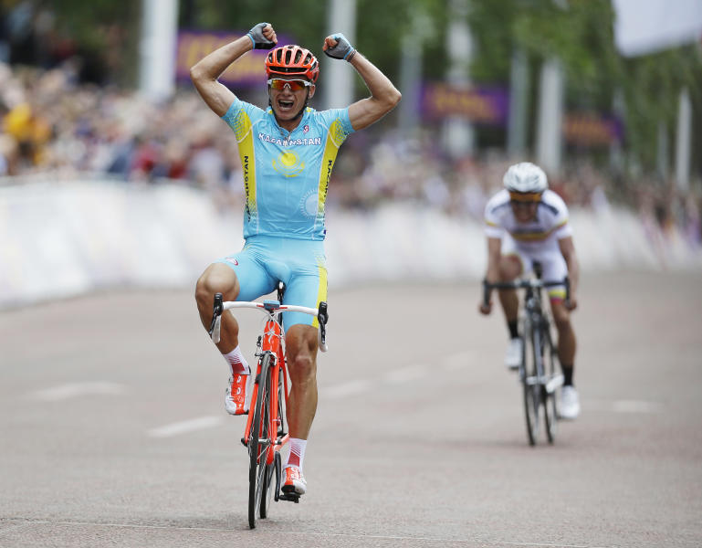 Kazakhstan's Alexandr Vinokourov celebrates as he crosses the finish line to win the Men's Road Cycling race at the 2012 Summer Olympics, Saturday, July 28, 2012, in London. Rigoberto Uran of Colombia took silver, with Alexander Kristoff of Norway claiming bronze. (AP Photo/Sergey Ponomarev)