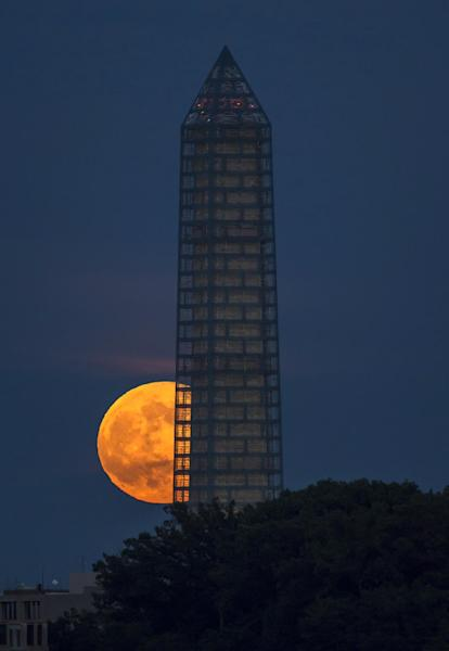 In this photo taken June 23, 2013, the moon rises behind the Washington Monument in Washington. While the Monument's earthquake damage is being repaired over the next year, 488 lamps will restore the tower's glow each night on the National Mall starting Monday, July 8, 2013. (AP Photo/NASA, Bill Ingalls, File)