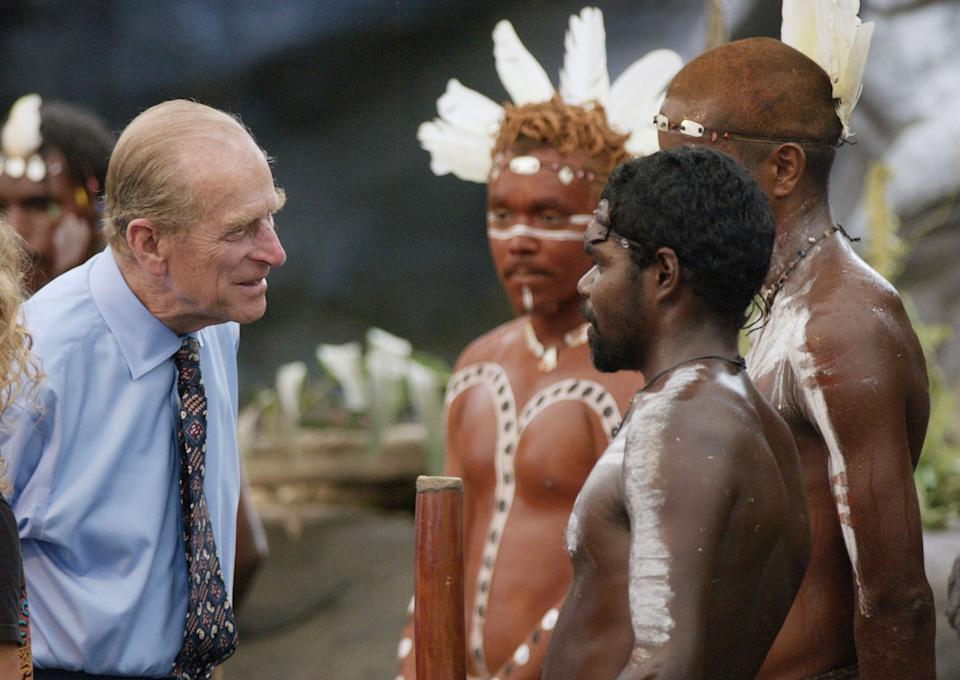 The Duke of Edinburgh talks to Aboriginal performers after watching a culture show at Tjapukai Aboriginal Culture Park, Cairns, Queensland, Australia. The Duke surprised the aborigines when he asked them