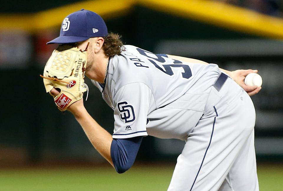 PHOENIX, AZ - APRIL 12:  Starting pitcher Chris Paddack #59 of the San Diego Padres peers in from behind his glove for a sign from catcher Austin Hedges #18 during the fourth inning of an MLB game against the Arizona Diamondbacks at Chase Field on April 12, 2019 in Phoenix, Arizona.  (Photo by Ralph Freso/Getty Images)