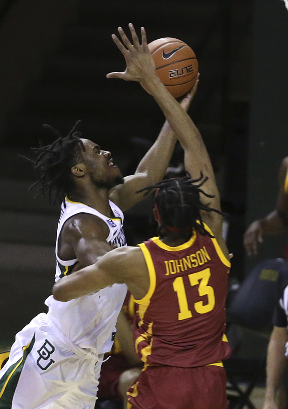 Baylor guard Davion Mitchell (45) attempts a shot past Iowa State forward Javan Johnson (13) in the first half of an NCAA college basketball game, Tuesday, Feb. 23, 2021, in Waco, Texas. (AP Photo/Jerry Larson)