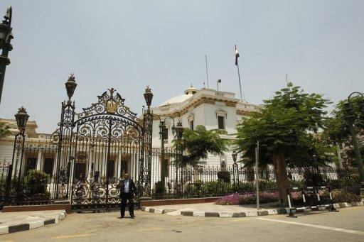 A security guard stands in front of Egypt's parliament building in Cairo. Egypt's top court has rejected a decree by President Mohamed Morsi to reinstate the parliament it ruled invalid, setting him on a collision course with the military which says the rule of law must be respected