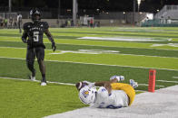 As Hawaii defensive back Khoury Bethley (5) looks on, San Jose State wide receiver Isaiah Hamilton (9) pulls in a touchdown pass during the first half of an NCAA college football game, Saturday, Sept. 18, 2021, in Honolulu. (AP Photo/Marco Garcia)