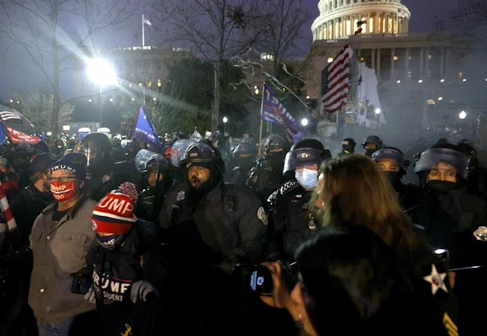 Police officers will confront protesters at the US Capitol on January 6 in Washington.