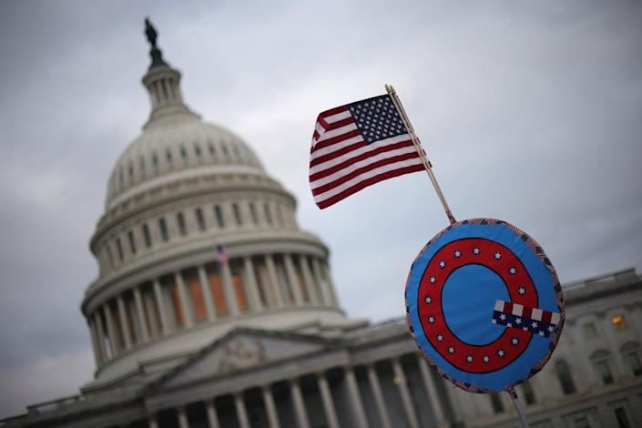"""<span class=""""caption"""">Many of those arrested in the U.S. Capitol siege on Jan. 6, 2021, were QAnon believers.</span> <span class=""""attribution""""><a class=""""link rapid-noclick-resp"""" href=""""https://www.gettyimages.com/detail/news-photo/supporters-of-u-s-president-donald-trump-fly-a-u-s-flag-news-photo/1294904312?adppopup=true"""" rel=""""nofollow noopener"""" target=""""_blank"""" data-ylk=""""slk:Win McNamee/Getty Images"""">Win McNamee/Getty Images</a></span>"""