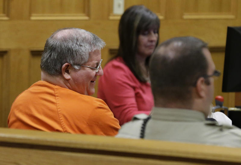 Bernie Tiede smiles as he talks to his attorney during a break in a court hearing granting his release at the Panola County court house in Carthage, Texas, Tuesday, May 6, 2014. The former mortician whose killing of a rich widow shook an East Texas town and later inspired a movie will soon go free, after the district attorney who prosecuted him agreed Tuesday to let him out of a life sentence. (AP Photo/LM Otero)