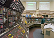 """FILE – In this April 12, 2005, file photo, operator Kevin Holko monitors the control room during a scheduled refueling shutdown at the Perry Nuclear Power Plant in North Perry, Ohio. A federal court docket showed that """"plea agreements"""" were filed Thursday, Oct. 29, 2020 for defendants Jeffrey Longstreth, a longtime political adviser, and Juan Cespedes, a lobbyist described by investigators as a """"key middleman"""" in a $60 million bribery case also involving ex-Ohio House Speaker Larry Householder alleged to have helped prop up this aging nuclear power plant and the Davis-Besse Nuclear Power Station in Oak Harbor, Ohio. (AP Photo/Mark Duncan, File)"""
