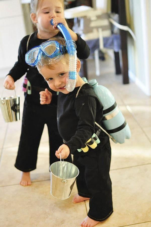"""<p>If you have a snorkel and goggles stuffed in the back of your closet—or can pick them up in an off-season sale—you've got most of what you need to make this awesome costume for the kiddo.</p><p><strong>Get the tutorial at <a href=""""https://www.delineateyourdwelling.com/diy-scuba-diver-halloween-costume/"""" rel=""""nofollow noopener"""" target=""""_blank"""" data-ylk=""""slk:Delineate Your Dwelling"""" class=""""link rapid-noclick-resp"""">Delineate Your Dwelling</a>.</strong></p><p><a class=""""link rapid-noclick-resp"""" href=""""https://www.amazon.com/Scotch-Electrical-Tape-4-Inch-66-Foot/dp/B001ULCB1O?tag=syn-yahoo-20&ascsubtag=%5Bartid%7C10050.g.23785711%5Bsrc%7Cyahoo-us"""" rel=""""nofollow noopener"""" target=""""_blank"""" data-ylk=""""slk:SHOP ELECTRICAL TAPE"""">SHOP ELECTRICAL TAPE</a><br></p>"""