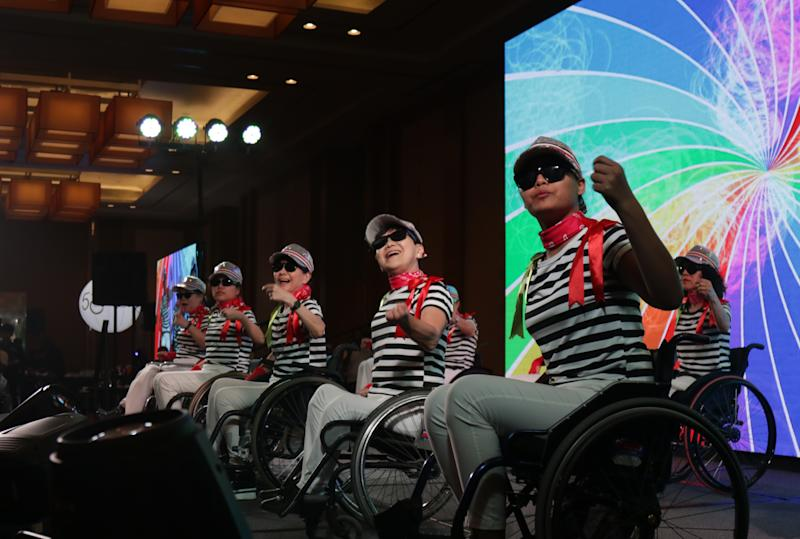 Members of the Handicaps Welfare Association performing at its 50th-anniversary dinner on 18 December, 2019. (PHOTO: Yahoo News Singapore)