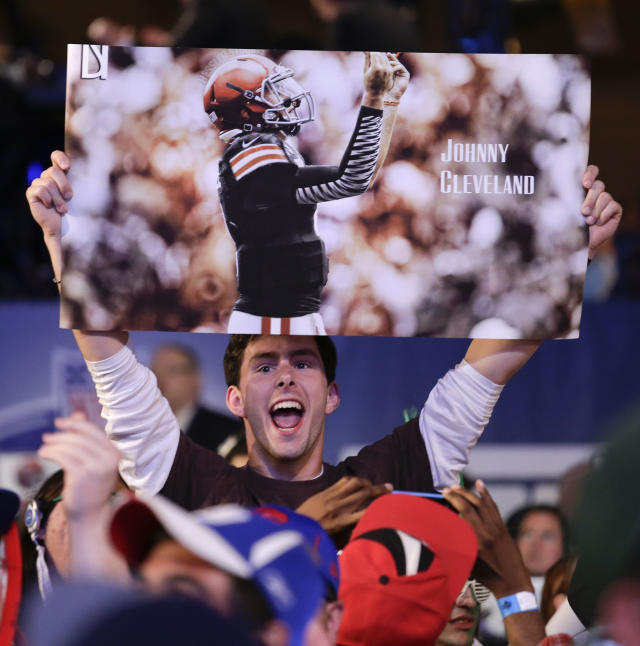 Football fan James Spearman, of Avon, Conn., reacts as Texas A&M quarterback Johnny Manziel is selected by the Cleveland Browns as the 22nd pick in the first round of the 2014 NFL Draft, Thursday, May 8, 2014, in New York. (AP Photo/Craig Ruttle)