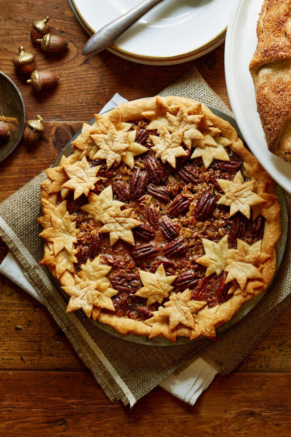 """<p>Looking for a classic dessert with a twist? Try out this decadent pecan pie recipe.</p><p><strong><a href=""""https://www.countryliving.com/food-drinks/recipes/a5863/granola-pecan-pie-recipe-clx1114/"""" rel=""""nofollow noopener"""" target=""""_blank"""" data-ylk=""""slk:Get the recipe"""" class=""""link rapid-noclick-resp"""">Get the recipe</a>.</strong></p>"""