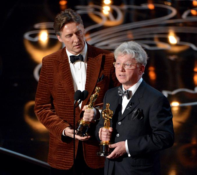 """Nicholas Reed, left, and Malcolm Clarke accept the award for best short subject documentary of the year for """"The Lady in Number 6: Music Saved My Life"""" on stage during the Oscars at the Dolby Theatre on Sunday, March 2, 2014, in Los Angeles. (Photo by John Shearer/Invision/AP)"""