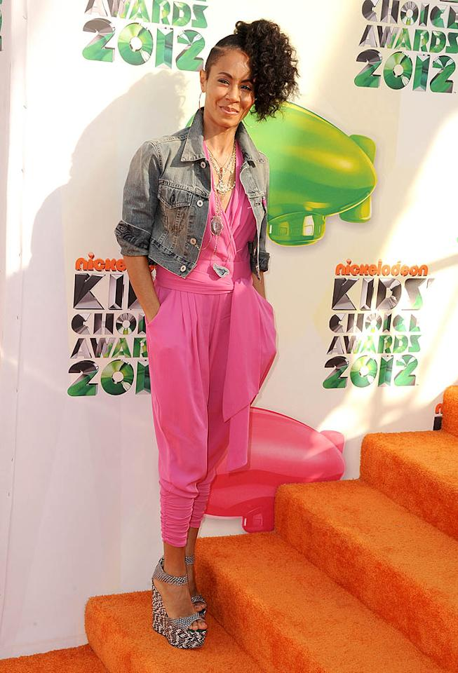 Unfortunately, Jada Pinkett Smith also aged herself considerably when she decided to dress like a 17-year-old for the 2012 Nickelodeon Kids' Choice Awards, which she attended with her children Willow, 11, and Jaden, 13. Jada's ensemble -- consisting of a pink Catherine Malandrino jumpsuit, cropped denim jacket, and patterned platform sandals -- would have looked cuter on Willow, but doesn't work quite as well on a 40-year-old. As for her shaved side ponytail ... can you say ridiculous? (3/31/2012)