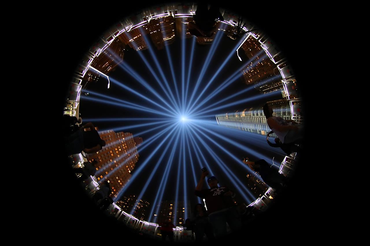 <p>People stand and inside the art installation of The Tribute in Light on Sept. 11, 2017. (Gordon Donovan/Yahoo News) </p>