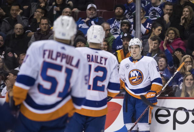 New York Islanders' Ryan Pulock, back right, celebrates his goal against the Vancouver Canucks during the first period of an NHL hockey game Saturday, Feb. 23, 2019, in Vancouver, British Columbia. (Darryl Dyck/The Canadian Press via AP)
