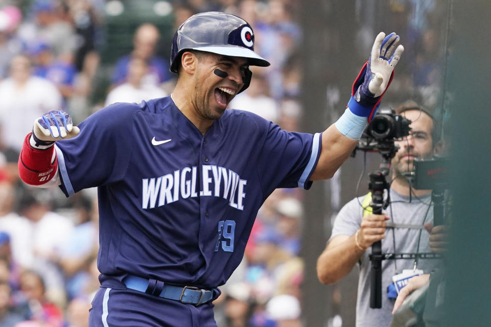 Chicago Cubs' Robinson Chirinos celebrates his solo home run as he walks to the dugout during the fourth inning of a baseball game against the Arizona Diamondbacks in Chicago, Friday, July 23, 2021. (AP Photo/Nam Y. Huh)