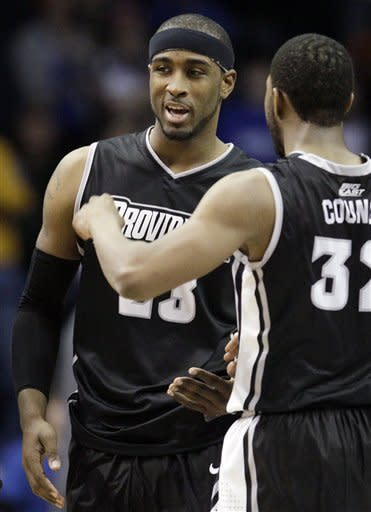 Providence forward Ladontae Henton (23) celebrates with guard Vincent Council (32) during the second half of an NCAA college basketball game against DePaul in Rosemont, Ill., on Saturday, Feb. 25, 2012. Providence won 73-71. (AP Photo/Nam Y. Huh)