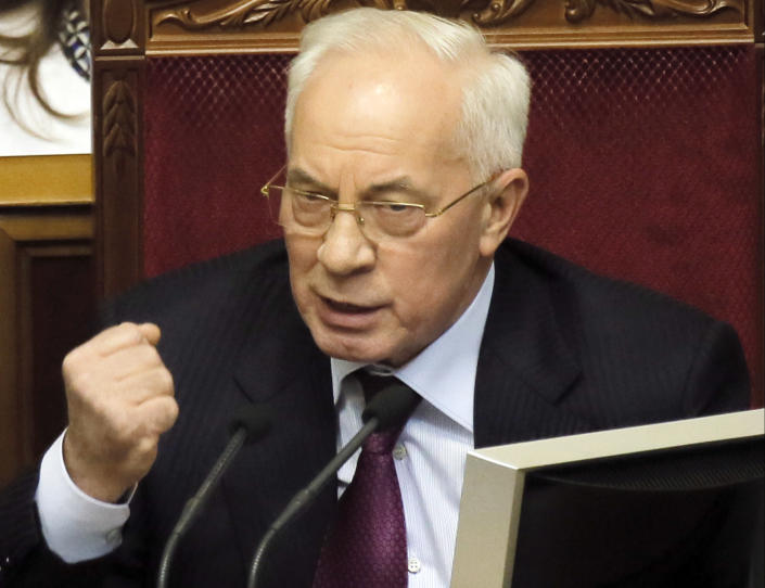 "FILE - In this Tuesday, Dec. 3, 2013 file photo, Ukraine's Prime Minister Mykola Azarov speaks to lawmakers during the parliament session in Kiev, Ukraine, Tuesday, Jan. 29, 2014. Azarov offered his resignation in order to encourage what he called ""social-political compromise.""(AP Photo/Efrem Lukatsky, File )"