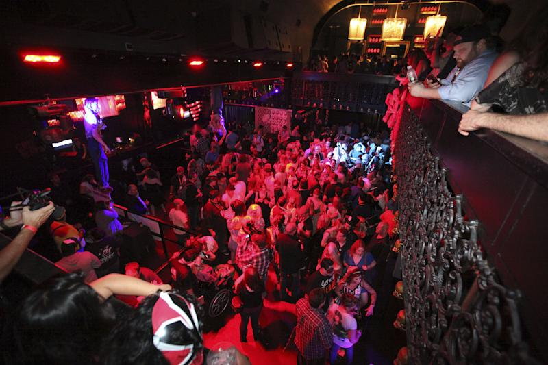 COMMERCIAL IMAGE - A general view of the crowd celebrating at the Fear Net and Resident Evil Party at Voyeur Nightclub for Comic-Con weekend on Friday July 13, 2012, in San Diego. (Photo by Jeff Bottari/Invision for MPI/Dark Sky Films/AP Images)