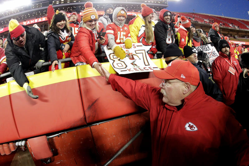 Kansas City Chiefs head coach Andy Reid celebrates with fans after the NFL AFC Championship football game against the Tennessee Titans Sunday, Jan. 19, 2020, in Kansas City, MO. The Chiefs won 35-24 to advance to Super Bowl 54. (AP Photo/Charlie Riedel)