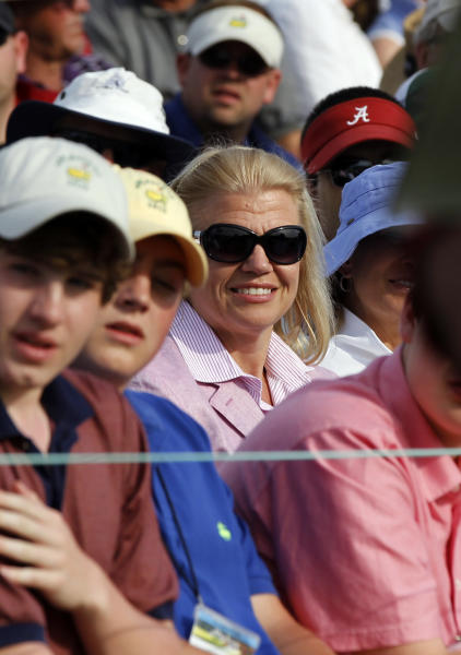 IBM CEO Virginia Rometty watches the fourth round of the Masters golf tournament from the gallery on the 18th green Sunday, April 8, 2012, in Augusta, Ga. (AP Photo/Chris O'Meara)