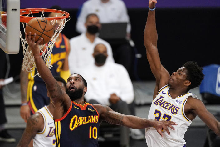 Golden State Warriors guard Brad Wanamaker, left, shoots as Los Angeles Lakers forward Kostas Antetokounmpo defends during the second half of an NBA basketball game Sunday, Feb. 28, 2021, in Los Angeles. The Lakers won 117-91. (AP Photo/Mark J. Terrill)