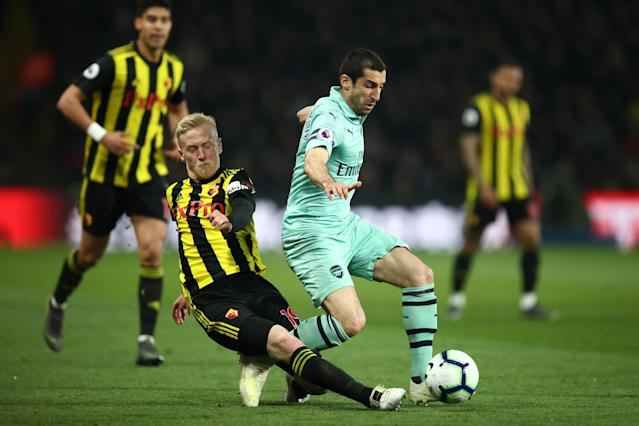 Henrikh Mkhitaryan of Arsenal is tackled by Will Hughes.