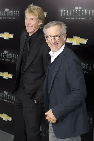 """Director Michael Bay (L) and producer Steven Spielberg arrive for the premiere of the movie """"Transformers: Age of Extinction"""" in New York June 25, 2014. REUTERS/Carlo Allegri"""
