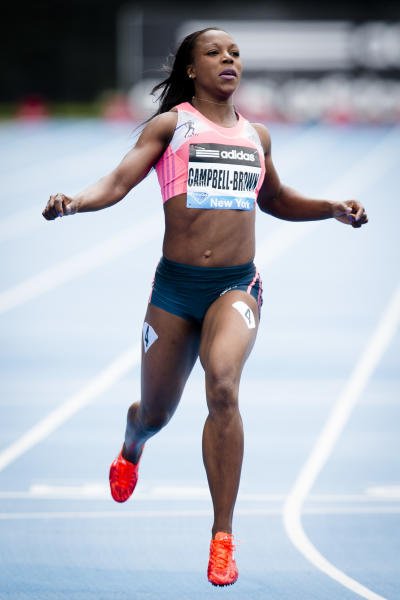 Veronica Campbell-Brown, representing Jamaica, wins the Women's 200m during the IAAF Diamond League Grand Prix competition on Randall's Island, Saturday, May 25, 2013, in New York. (AP Photo/John Minchillo)