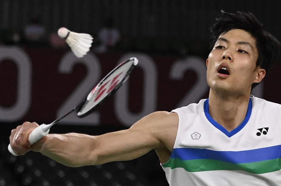 Taiwan's Chou Tien-chen hits a shot to China's Chen Long in their men's singles badminton quarter final match during the Tokyo 2020 Olympic Games at the Musashino Forest Sports Plaza in Tokyo on July 31, 2021. / AFP / Alexander NEMENOV